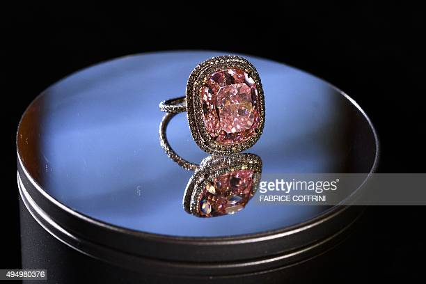 This photo taken on on October 30 2015 in Geneva shows a 1608carat pink diamond on display during a press preview by the auction house Christie's The...