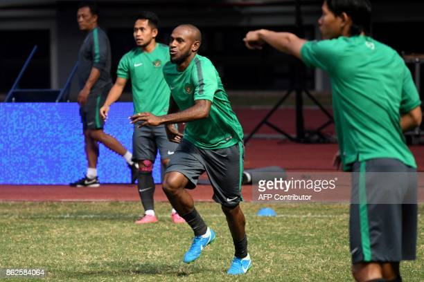 This photo taken on September 1 2017 shows Boaz Solossa captain of Indonesia's national football team training with the team at the Bekasi Patriot...