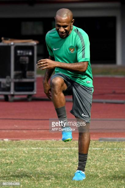 This photo taken on September 1 2017 shows Boaz Solossa captain of Indonesia's football team training at the Bekasi Patriot stadium on the outskirts...