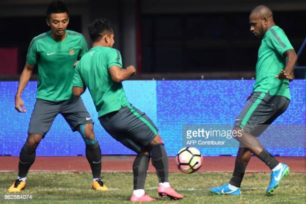 This photo taken on September 1 2017 shows Boaz Solossa the captain of Indonesia's national football team training with the national team at the...
