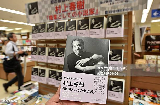 This photo taken on September 10 2015 shows the latest book by popular Japanese novelist Haruki Murakami an autobiographical essay which translates...