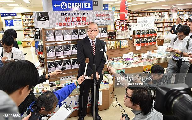 This photo taken on September 10 2015 shows the store manager for major Japanese bookstore chain Kinokuniya Toru Nishine speaking about the launch of...