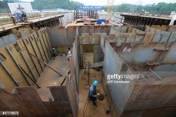 This photo taken on September 14 2017 shows a view of the construction of the world's first fullsize replica of the Titanic in Suining in China's...
