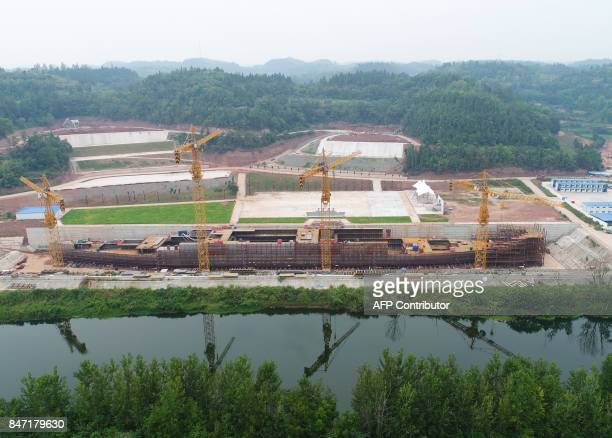 This photo taken on September 14 2017 shows an aerial view of the construction of the world's first fullsize replica of the Titanic in Suining in...
