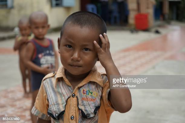 This photo taken on September 22 2017 in Sittwe Rakhine state shows an ethnic Rakhine boy inside the compound of a monastery which is sheltering...