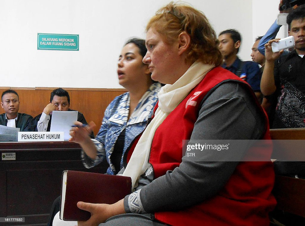 This photo taken on September 23, 2013 shows British national Andrea Waldeck (R) with a translator appearing before an Indonesian court in Surabaya in eastern Java island, as she faces charges of trafficking about 1.5 kilograms (three pounds) of crystal methamphetamine, an offence punishable by death, prosecutors said. Waldeck, 43, was arrested in late April at a hotel in city of Surabaya after arriving from China.