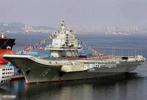 This photo taken on September 24 2012 shows China's first aircraft carrier a former Soviet carrier called the Varyag docked after its handover to the...