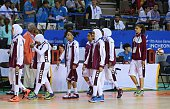 This photo taken on September 24 2014 shows members of the Qatar women's basketball team walking off the court after withdrawing ahead of their...