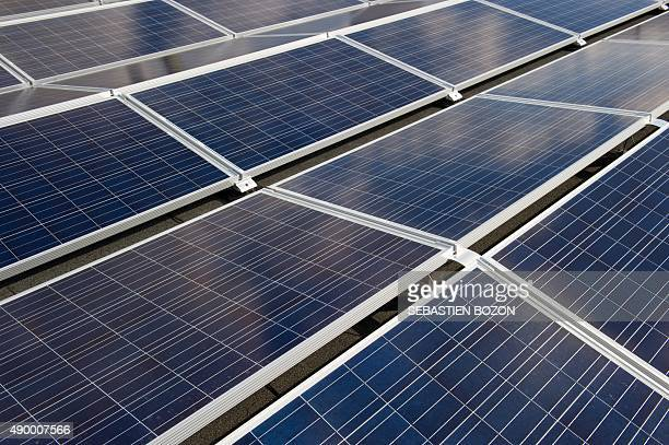 This photo taken on September 24 2015 shows photovoltaic panels in Ungersheim eastern France AFP PHOTO / SEBASTIEN BOZON