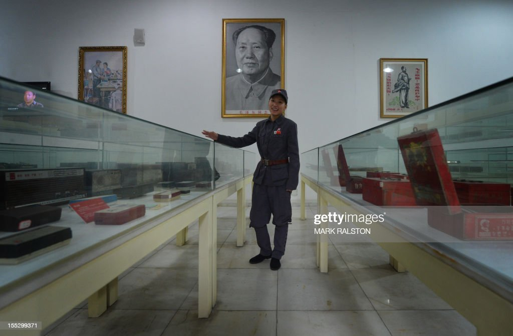 This photo taken on September 25, 2012 shows a staff member dressed as a Revolutionary Guard at Fan Jianchuan's Cultural Revolution museum near Chengdu, in Sichuan province. A series of museums commemorating the decade of violence during China's Cultural Revolution is opening up normally tightly controlled discussion of the chaotic era -- but only up to a point. AFP PHOTO/Mark RALSTON