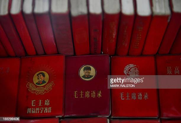 This photo taken on September 25 2012 shows Little Red Books containing the thoughts of former Chinese leader Mao Zedong at Fan Jianchuan's Cultural...