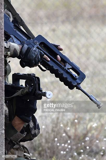 This photo taken on September 25 2016 in at the Caylus military installation in the TarnetGaronne region shows mock weapons used during the 'Colibri'...