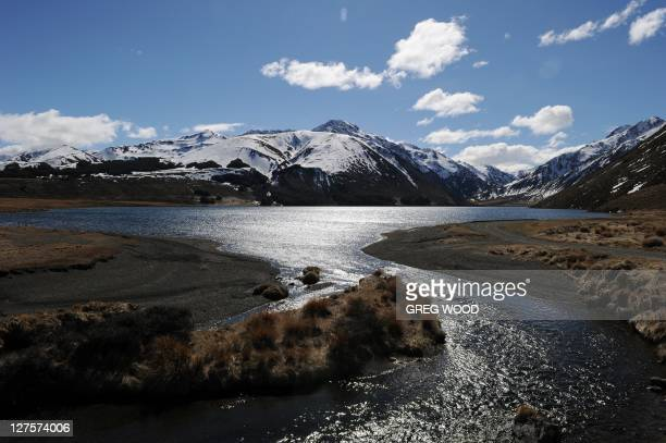 This photo taken on September 26 2011 shows a lake stream and snow capped mountains near Hanmer Springs on New Zealand's South Island Hanmer Springs...
