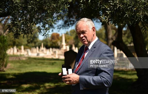This photo taken on September 27 2017 shows Adelaide Cemeteries Authority chief executive Robert Pitt talking to AFP under an olive tree amongst the...