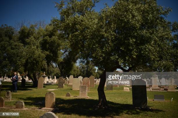This photo taken on September 27 2017 shows olive trees growing amongst the graves in Adelaide's West Terrace Cemetery From the graveside to the...
