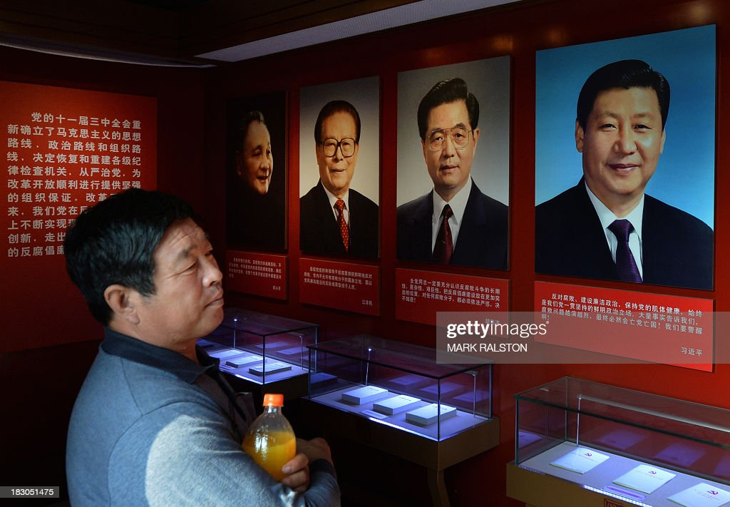 This photo taken on September 28, 2013 shows portraits of the Chinese President Xi Jinping (R) along with his predecessors (R-L) Hu Jintao, Jiang Zemin and Deng Xiaoping on display at a museum in Tianjin. China's President Xi Jinping said territorial disputes with Southeast Asia should be resolved in a 'peaceful manner' as he sought to mend frayed ties during the first speech by a foreign leader to the Indonesian parliament. Making his first visit to the region since taking power in March, Xi turned to the issue of maritime territorial disputes -- China's increasingly assertive claims to almost the entire South China Sea have sparked territorial rows in recent times, in particular with the Philippines and Vietnam. AFP PHOTO/Mark RALSTON