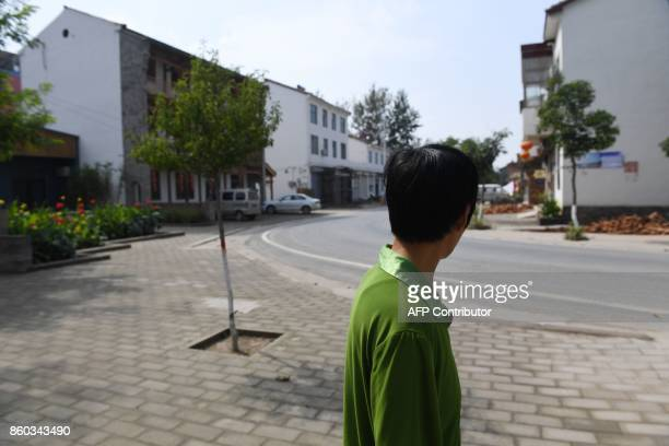 This photo taken on September 28 2017 shows a man walking on a paved area in Zhangzhuang village in Lankao in China's central Henan province When...