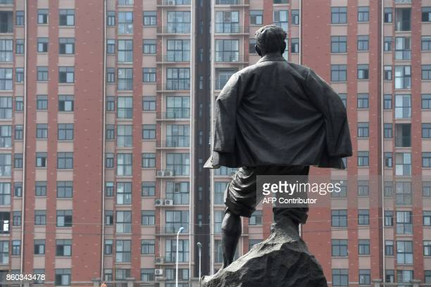 This photo taken on September 28 2017 shows a statue of Jiao Yulu an official who became a national hero after famously working himself to death...