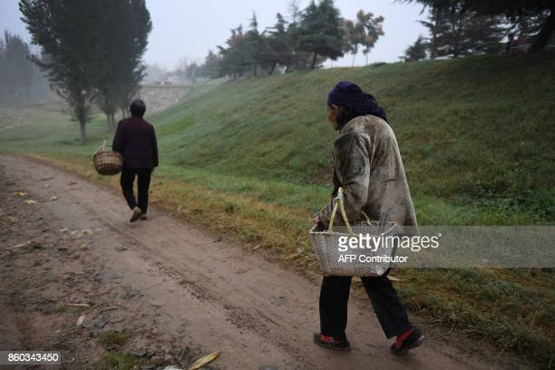 This photo taken on September 28 2017 shows women walking near a village in Lankao in China's central Henan province When President Xi Jinping last...