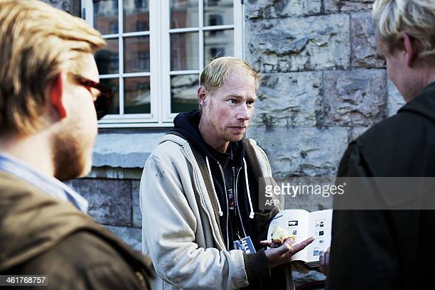 This photo taken on September 29 2013 in Copenhagen shows Danish drug addict Henrik selling the Danish magazine 'Illegal' a magazine about drugs and...