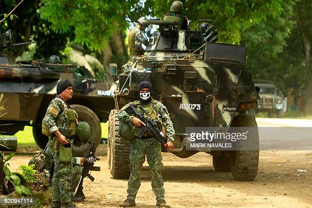 This photo taken on September 5 2016 shows Philippine soldiers standing guard next to an Armored Personnel Carrier inside a military camp in Jolo...