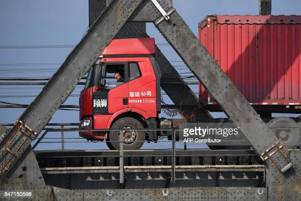 This photo taken on September 5 2017 shows a truck returning over the Friendship Bridge from the North Korean town of Sinuiju to the Chinese border...
