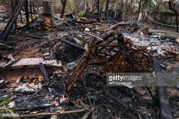 This photo taken on September 6 2017 shows the remains of houses burnt allegedly by Rohingya militants in Maungdaw township in Rakhine State in...