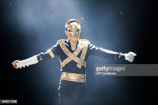 TOPSHOT This photo taken on September 8 2017 shows Jack Ma chairman of Alibaba group dancing to a medley of Michael Jackson songs during the Alibaba...