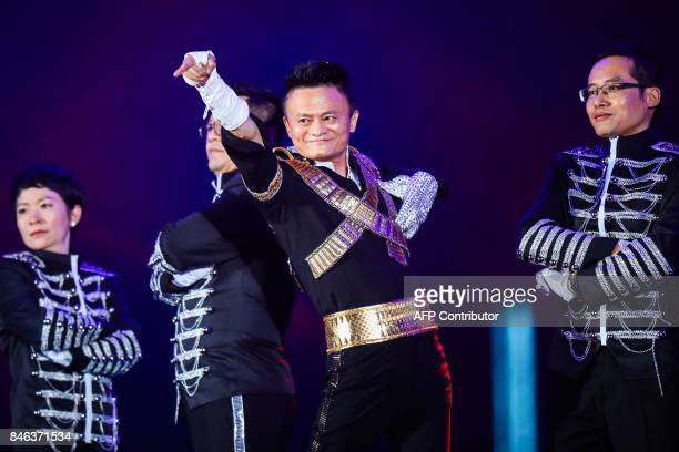 This photo taken on September 8 2017 shows Jack Ma chairman of Alibaba group dancing to a medley of Michael Jackson songs during the Alibaba Annual...