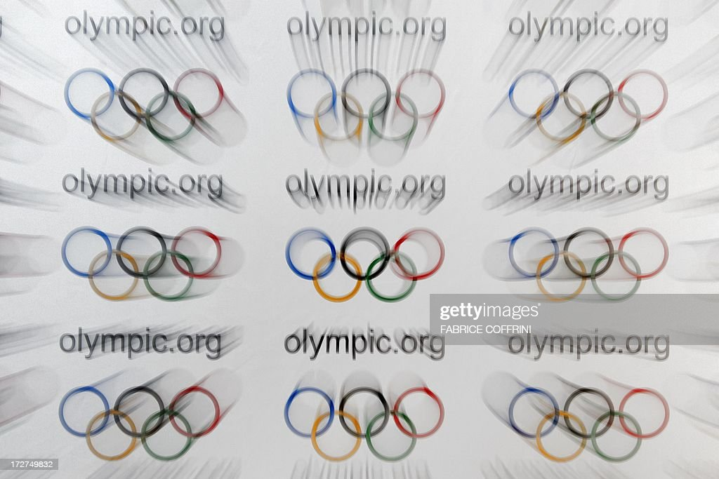 This photo taken with a zoom effect show the Olympic rings on a sign on July 4, 2013 during a session of the International Olympic Committee (IOC) in Lausanne.