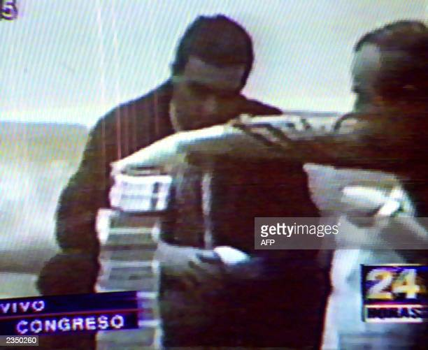 This photo was taken from the video shown in the Peruvian Congress on March 8 2001 showing fugitive former presidential adviser Vladimiro Montesinos...