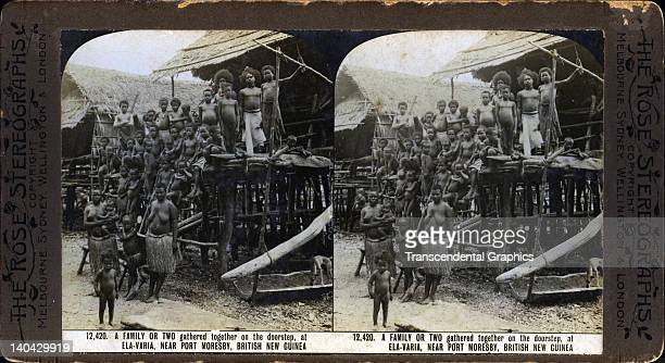 This photograph shows a gathering of family and village members posing for a stereo view photograph taken in Papa New Guinea in 1908