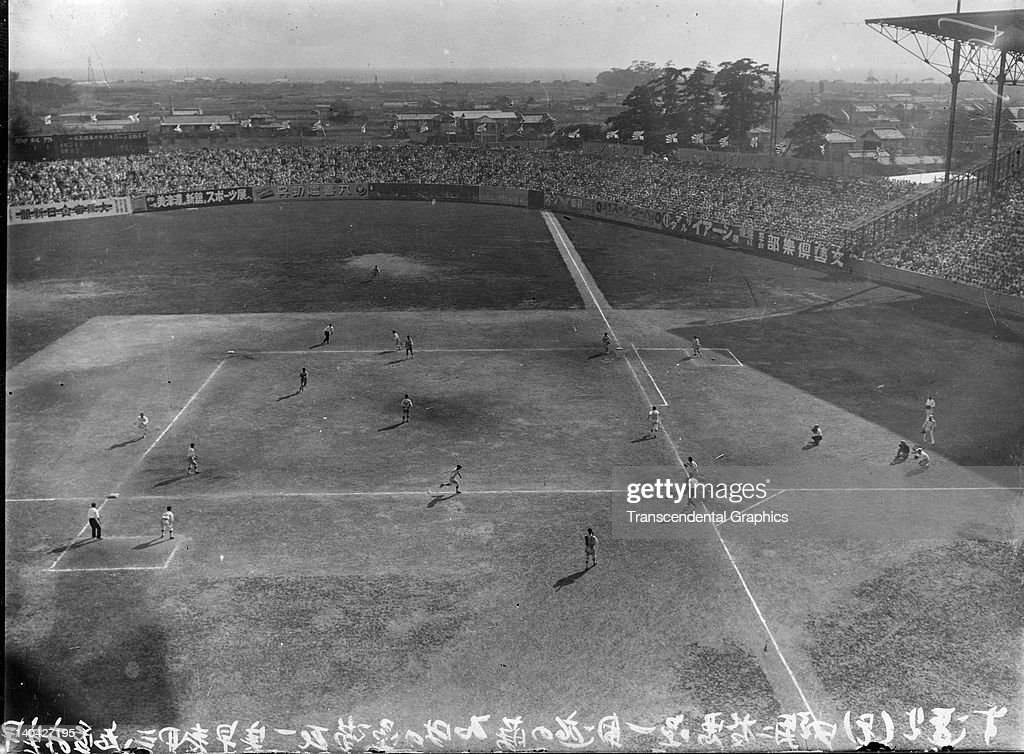 This photograph shows a high school championship Japanese baseball game being played at Koshien Stadium in Osaka Japan in 1920