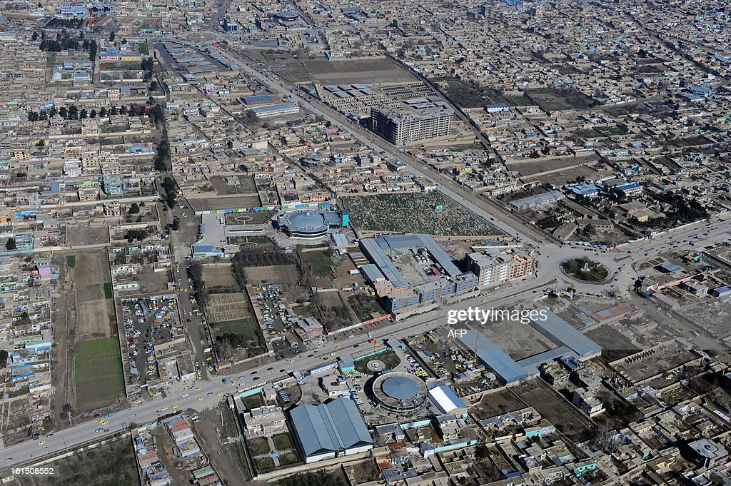 This photograph taken from a helicopter shows an aerial view of Mazar-i-Sharif in Balkh province on February 4, 2013. Once known as the 'mother of cities,' the ancient city of Balkh was a popular destination along the ancient Silk Route. Balkh was destroyed by Mongol conqueror Genghis Khan during his rule, with the city's ruins remaining as a tourist attraction today. AFP PHOTO/ Qais Usyan