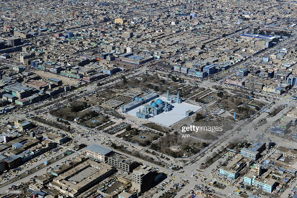 This photograph taken from a helicopter shows an aerial view of the Hazrat-e Ali shrine in Mazar-i-Sharif in Balkh province on February 4, 2013. Once known as the 'mother of cities,' the ancient city of Balkh was a popular destination along the ancient Silk Route. Balkh was destroyed by Mongol conqueror Genghis Khan during his rule, with the city's ruins remaining as a tourist attraction today. AFP PHOTO/ Qais Usyan
