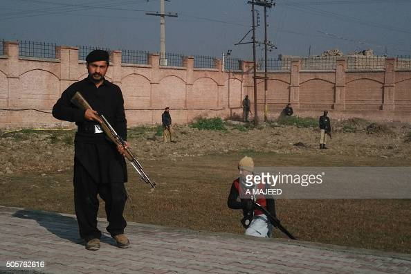 This photograph taken from a mobile phone shows Pakistani security personnel taking position outside the Bacha Khan university following an attack by...