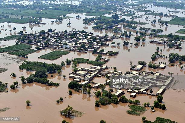 This photograph taken from a Pakistan army helicopter shows an aerial view of the flooded area of Peer Kot in Jhang in central Punjab province on...
