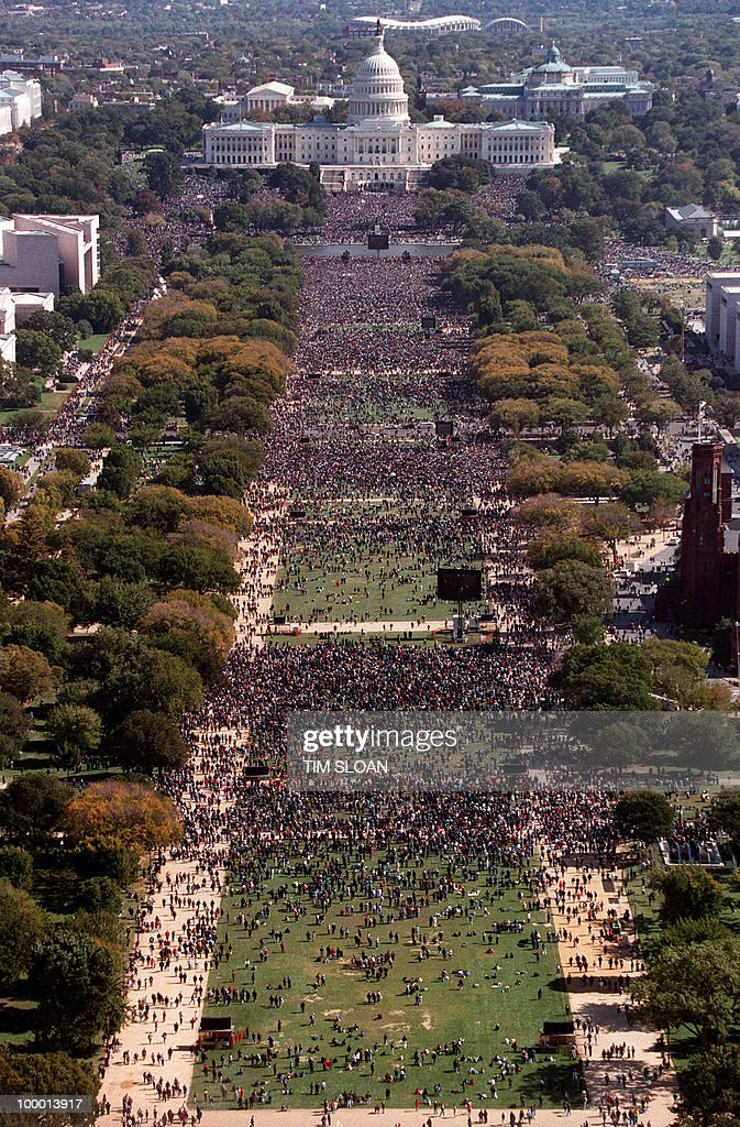 This photograph taken from the top of the Washington Monument shows thousands of people on the Mall in front of the US Capitol during the 'Million Man March' in Washington D.C., 16 October 1995. The march, called by Nation of Islam leader Louis Farrakhan, is intended as a day for back men to unite and pledge self-reliance and commitment to their families and communities.