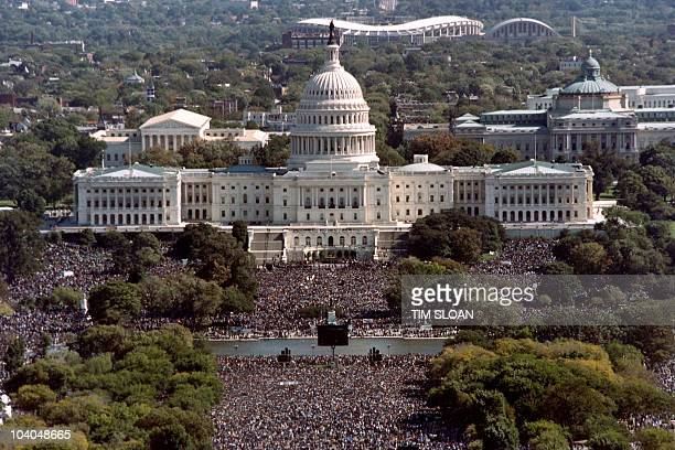 This photograph taken from the top of the Washington Monument shows thousands of people on the Mall in front of the US Capitol during the 'Million...
