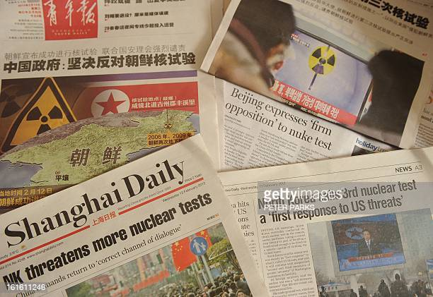 This photograph taken in Shanghai on February 13 2013 shows the reaction to North Korea's nuclear test on pages of some Chinese newspapers Chinese...