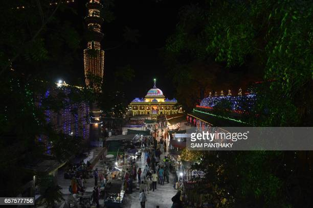 This photograph taken late March 24 shows a general view as Indian Muslim devotees throng The ShahEAlam Roja in Ahmedabad during the marking of the...