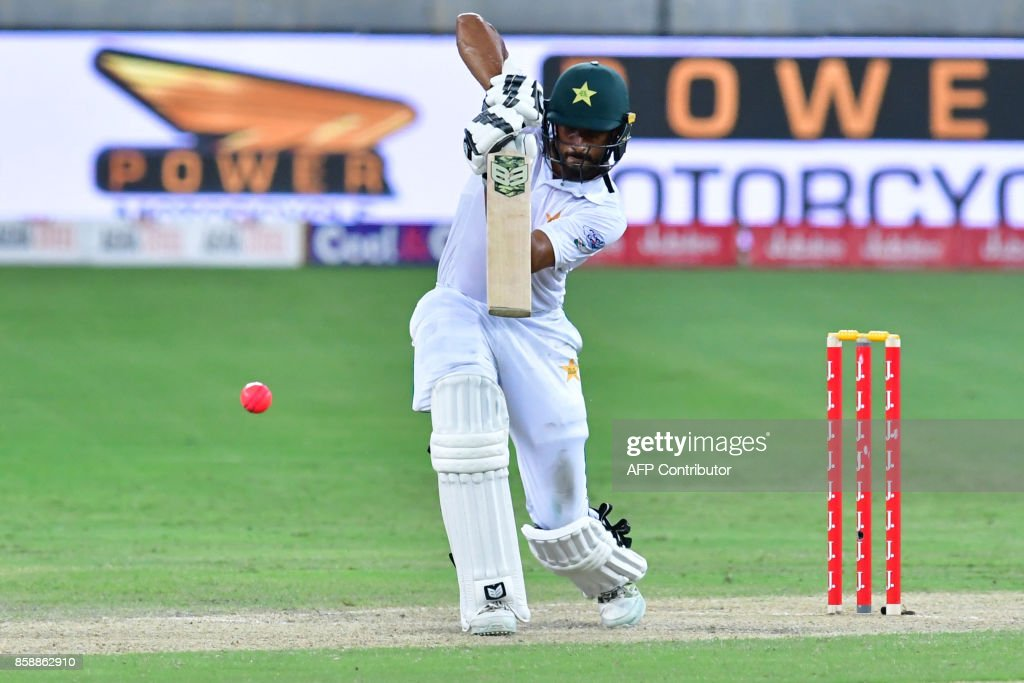 This photograph taken Ocotber 7, 2017 shows Shan Masood of Pakistan playing a shot during the second day of the second Test cricket match between Sri Lanka and Pakistan at Dubai International Stadium in Dubai. /