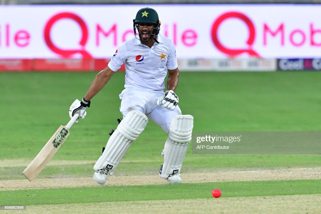 This photograph taken Ocotber 7, 2017 shows Shan Masood of Pakistan running between wickets during the second day of the second Test cricket match between Sri Lanka and Pakistan at Dubai International Stadium in Dubai. /