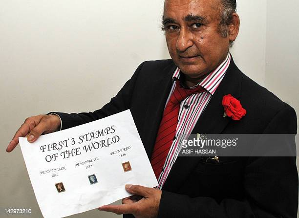 This photograph taken on April 14 2012 shows Mohammad Ali Shah the Pakistan's sports minister of Sindh province displaying his collection including a...