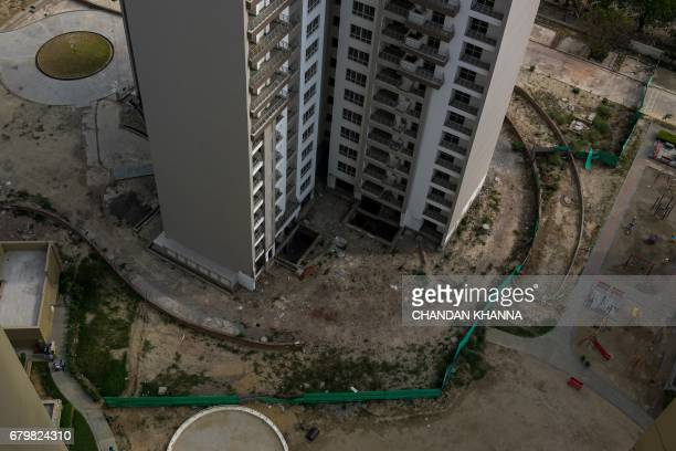 This photograph taken on April 27 shows incomplete residential apartments in Greater Noida some 25 kilometres southeast of New Delhi From the...