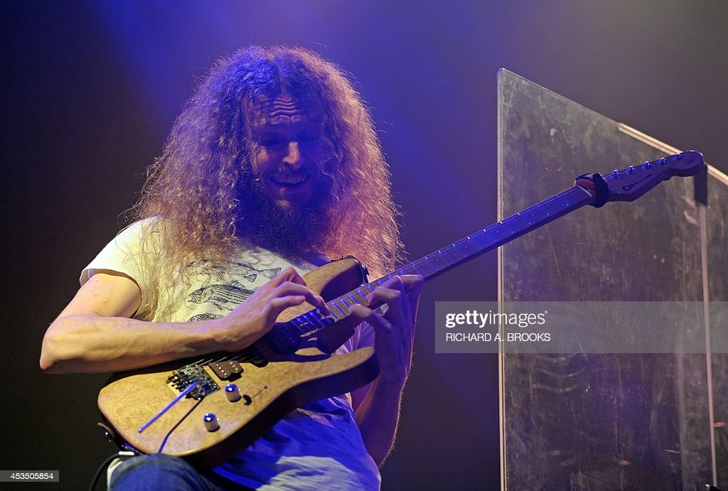 This photograph taken on August 11, 2014, shows guitarist Guthrie Govan of the band The Aristocrats performing in Hong Kong. The jazz-fusion oriented hard rock trio are touring Asia to promote their 2013 release 'Culture Clash'.