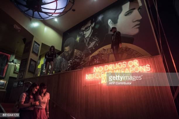 This photograph taken on August 12 shows a sign reading 'No drugs or nuclear weapons allowed' at the entrance to a restaurant in the Tamuning area of...