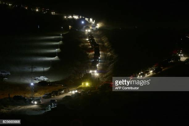 TOPSHOT This photograph taken on August 2 shows a convoy carrying Syrian fighters and their families who have been in eastern Lebanon since the...