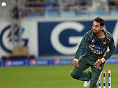 This photograph taken on December 5 shows Pakistani allrounder Mohammad Hafeez delivering the ball during the second and last International T20...
