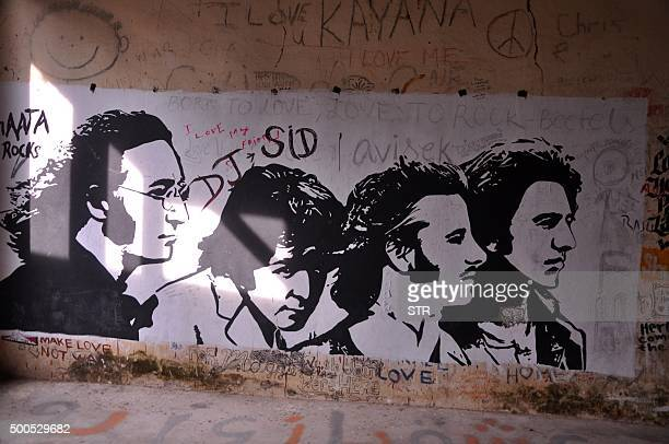 This photograph taken on December 8 2015 shows graffiti painted on the walls of a hall at the Beatles ashram as the former ashram of the selfstyled...